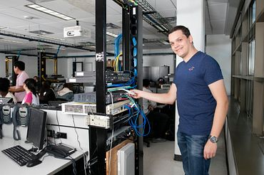 picture of a Centennial College part-time networking program student working in a computer lab