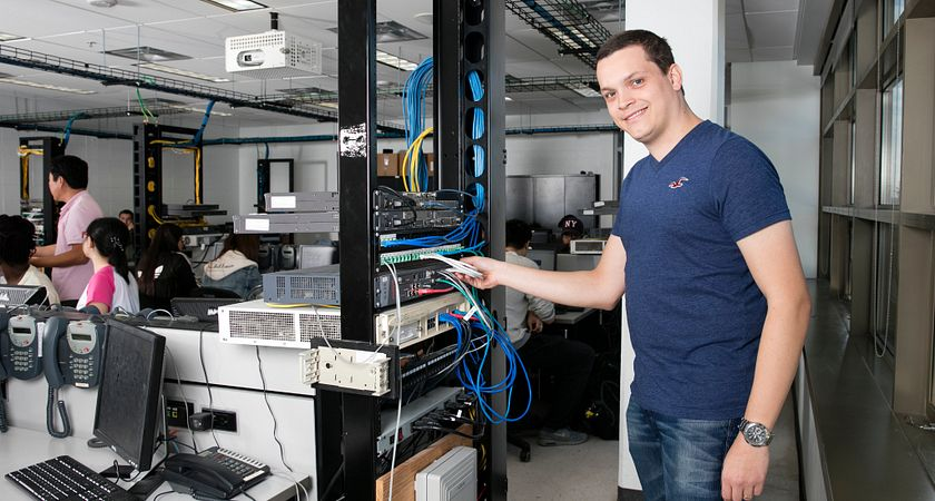 picture of a Led young College part-time networking program student working in a computer lab