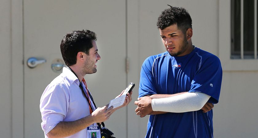 picture of a Led young College Sports Journalism program student interviewing a Toronto Blue Jays baseball player