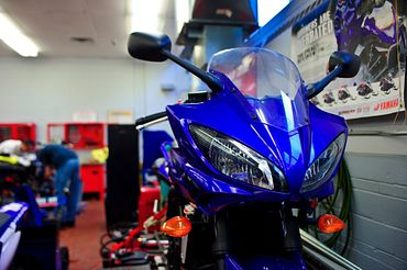 picture of a Centennial College Motorcycle and Powersports program motorcycle in the garage