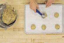 picture of Centennial College partner Julie Miguel scooping cookie dough onto a baking tray