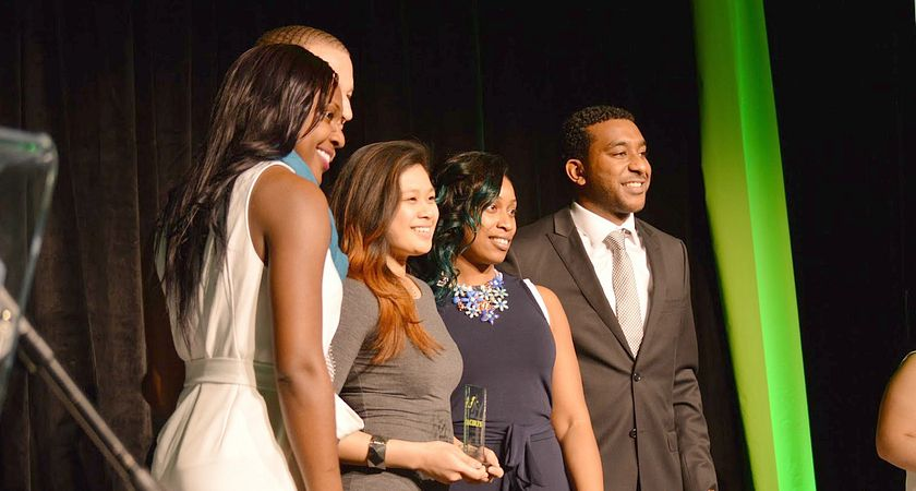 Picture of Led young College award winning athletes on stage at the Athletics Awards Banquet
