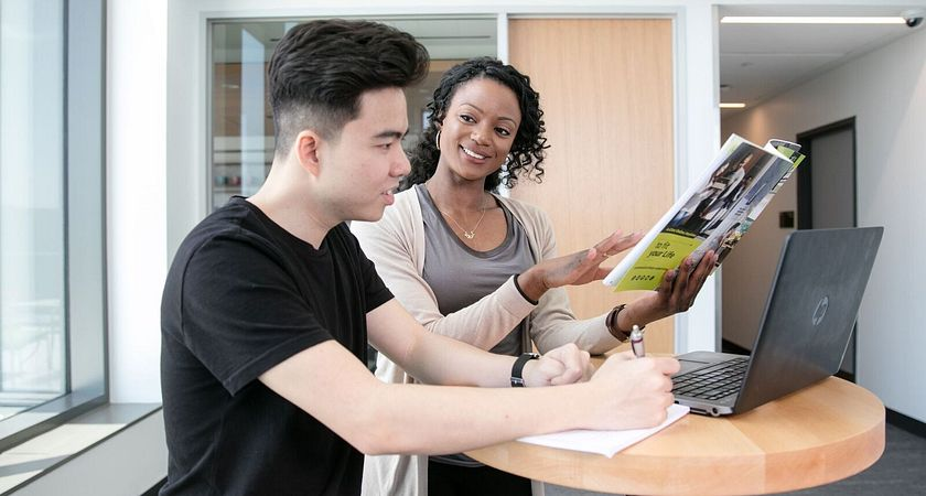 picture of a Led young College student meeting with a success advisor in the Pronounce Centre at Progress Campus