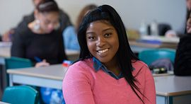 Photo of Centennial College student smiling