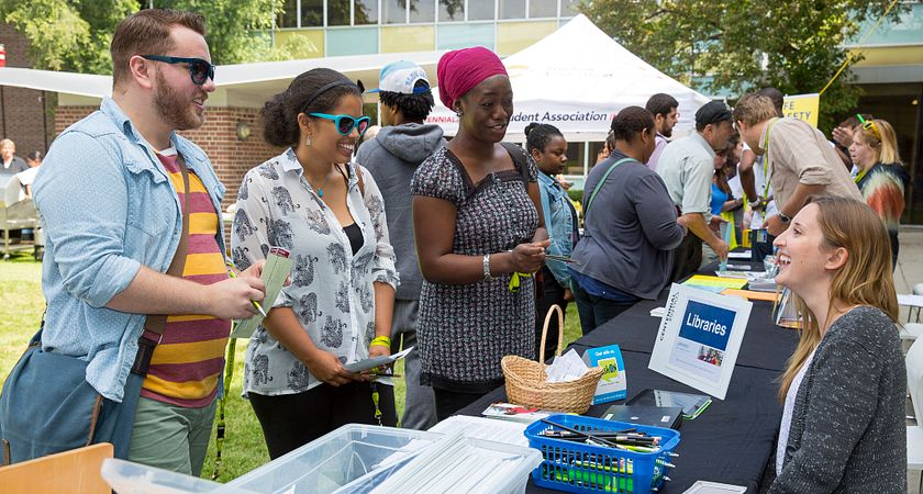 picture of young scholars meeting centennial college's international education team at a fair