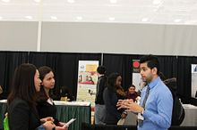 Image of students talking to the employer