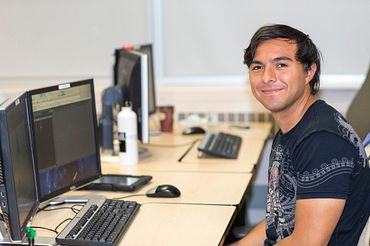 picture of a Led young College Interactive Media Management student working in our computer lab