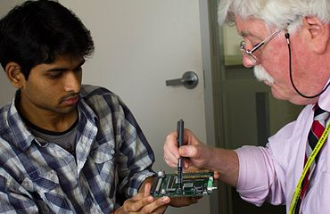 picture of a centennial college student and staff working together on a research project