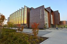 library and academic learning facility exterior at sunset with students pic 4