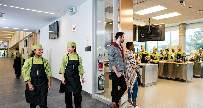 picture of Centennial College Part-time Learning culinary students learning in a baking lab