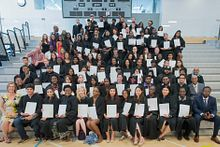 Picture of Centennial College HYPE students at graduation in the Progress Campus Gym