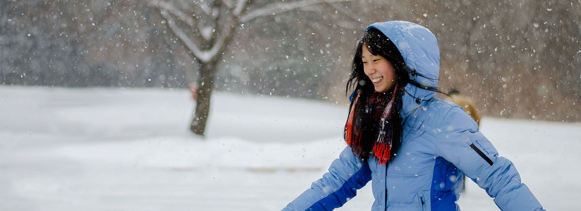 picture of a centennial college student skating at morningside park smiling during a winter snowfall