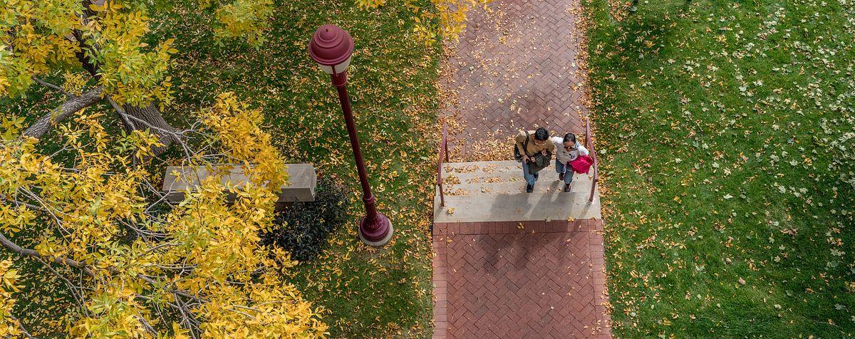 DU community members walking along pathway on campus