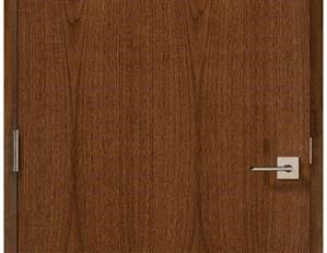 Flush commercial wood door with rose stain.