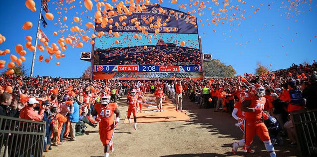 The Clemson Tigers run down the hill at Memorial Stadium in Death Valley.