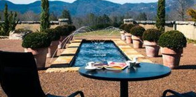 The pool and surrounding mountain view at Hotel Domestique.