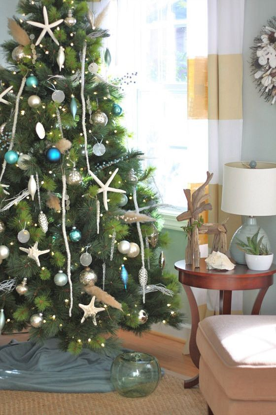 the result is a vibrant christmas tree that is reminiscent of summers at the beach