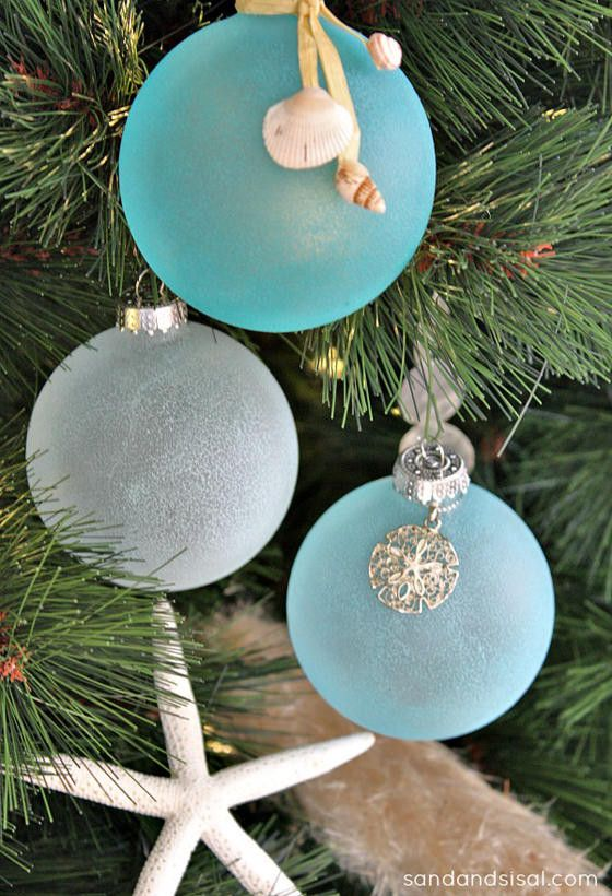 ivory white christmas balls on the other hand look like giant pearls nestled between the branches this palette of white and turquoise aqua