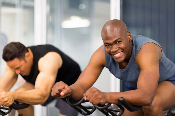 Men on a stationary exercise bike