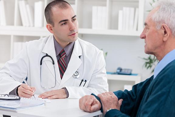 older man at doctor consultation