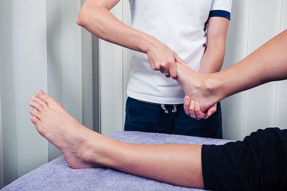 therapist treating a foot