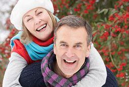 Senior Couple Outside In Snowy Landscape