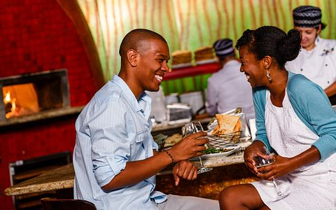 couple laughing and eating