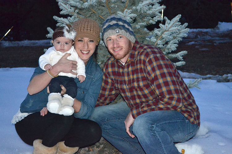 Caroline with husband, Kevin and baby girl, Etta, spending Christmas at home in Colorado.