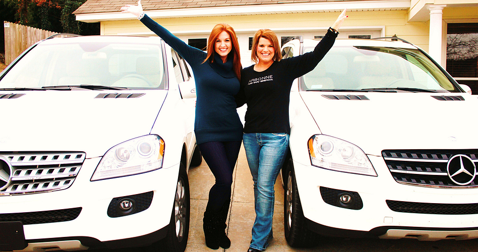 Gena and her RVP, Sharon Decker, with their Mercedes.