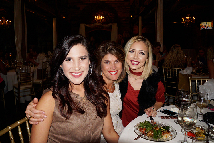 Peyton, ERVP Bridgette Burleson, and her first RVP, Avery McCain, at ENVP Cecilia Stoll's VP Retreat dinner.