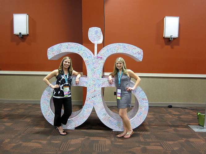 Allison Paschke (DM) and Aimee in front of Arbonne Logo Sculpture — GTC 2013.