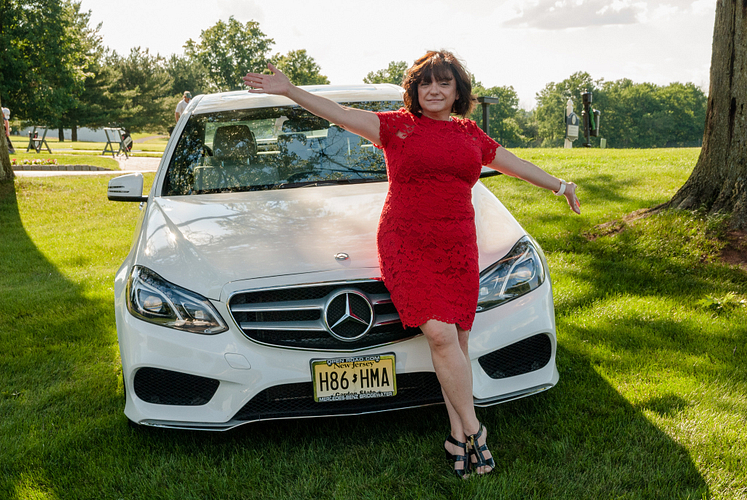 Lola with her new Mercedes-Benz.