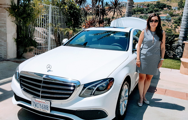 Kezia and her new Mercedez-Benz.