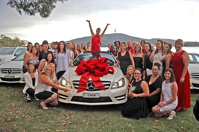 Katharina celebrating receiving her white Mercedes-Benz! }}