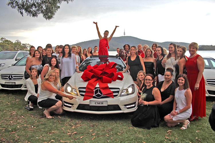 Katharina celebrating receiving her white Mercedes-Benz!