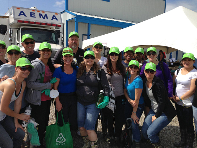 Amber with many other Independent Consultants and Arbonne Corporate Canada volunteering in High River, AB, after the devastating floods in Southern Alberta in June 2013.