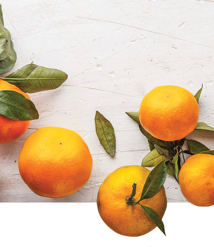Mandarins-at-the-right-on-the-white-wooden-table copy.png