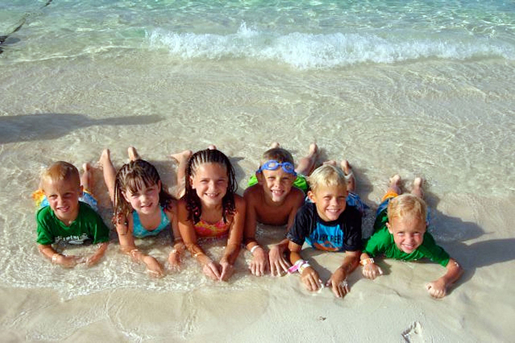 Audra's three boys enjoy the beach with their cousins in the Bahamas.