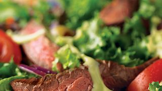 grilled-skirt-steak-salad-with-creamy-avocado-dressing-vertical.eps
