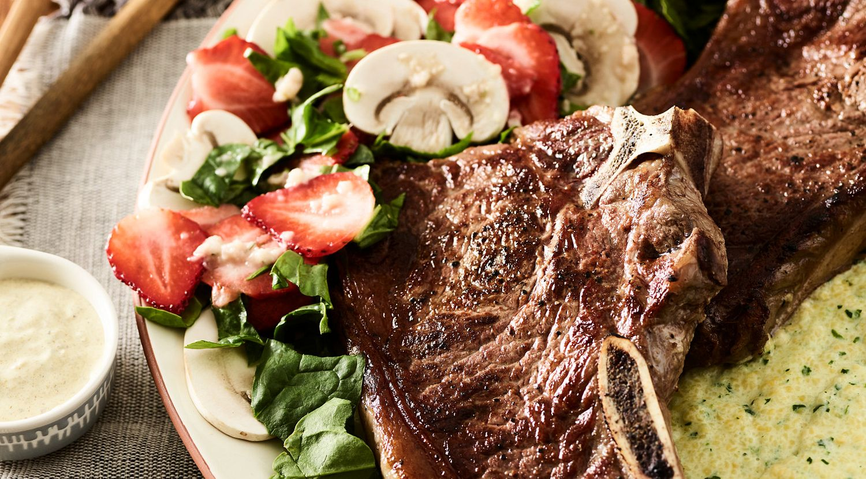 Beef Strip Steaks with Kale Polenta and Mushroom-Strawberry Salad