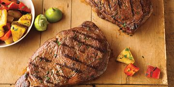 Caribbean Ribeye Steaks with Grilled Pineapple Salad