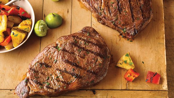 caribbean-ribeye-steaks-with-grilled-pineapple-salad
