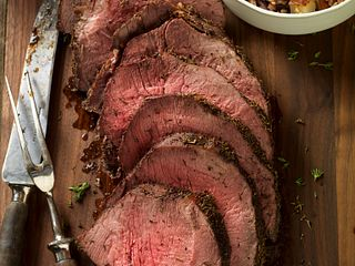 Thyme-Rubbed Beef Round Tip with Roasted Onion and Pear Wild Rice Vertical