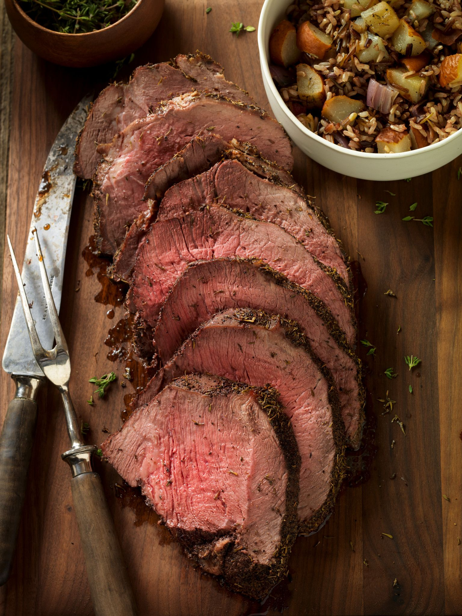Thyme-Rubbed Beef Round Tip with Roasted Onion and Pear Wild Rice