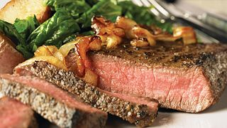 Peppered Beef Steaks with Caramelized Onions