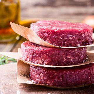Raw ground beef, round patties for making burgers