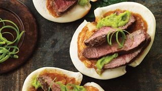 "Seems like Chinese-style bao buns are the hottest news in hand-held.  And nothing puts ""wow"" on a bao like thin slices of grilled five-spice-seasoned Flat Iron steak with creamy hoisin peanut sauce and scallion oil.  Looking to serve a small plate that makes a big statement?  Slice up some steak and bao down."