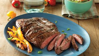 Flank Steak benefits from a tenderizing marinade of balsamic vinegar, basil, Dijon mustard and garlic.