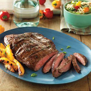 Flank Steak benefits from a tenderizing marinade of balsamic vinegar, basil, Dijon mustard and garlic.