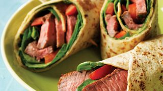 An easy chimichurri sauce adds big flavor to wraps made with steak, spinach and red bell pepper.